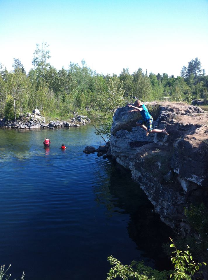 My son jumping into the local swimming hole, otherwise known as the Rock Quarry.